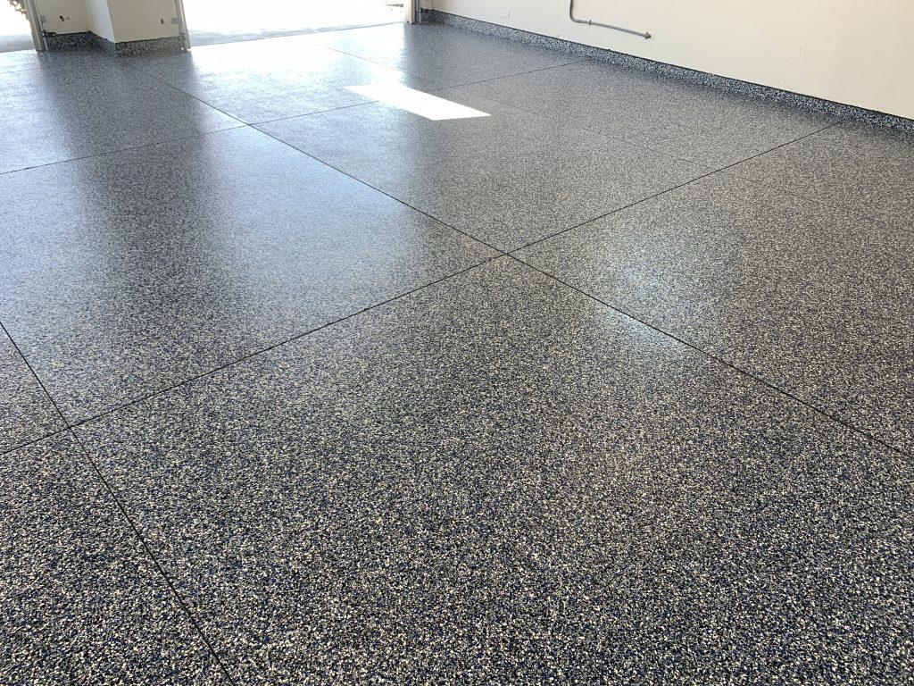 Black & Gray epoxy garage floor with 4 cracks in boise idaho house
