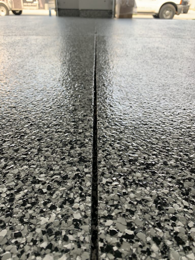 black and white with a little gray speckled epoxy garage floor