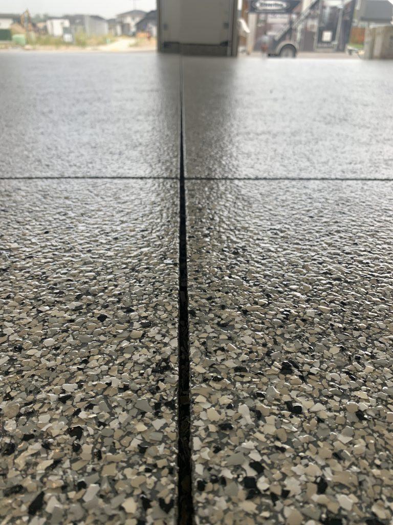 Lighter tan, white and black garage epoxy floors