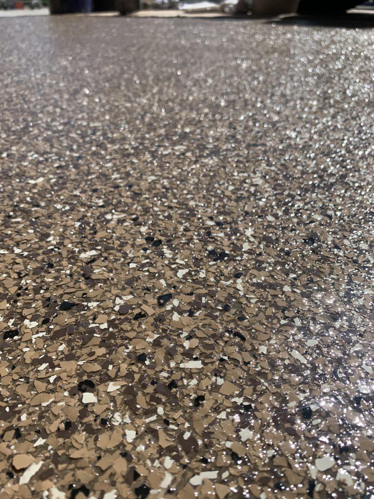 Brown and black epoxy garage floor